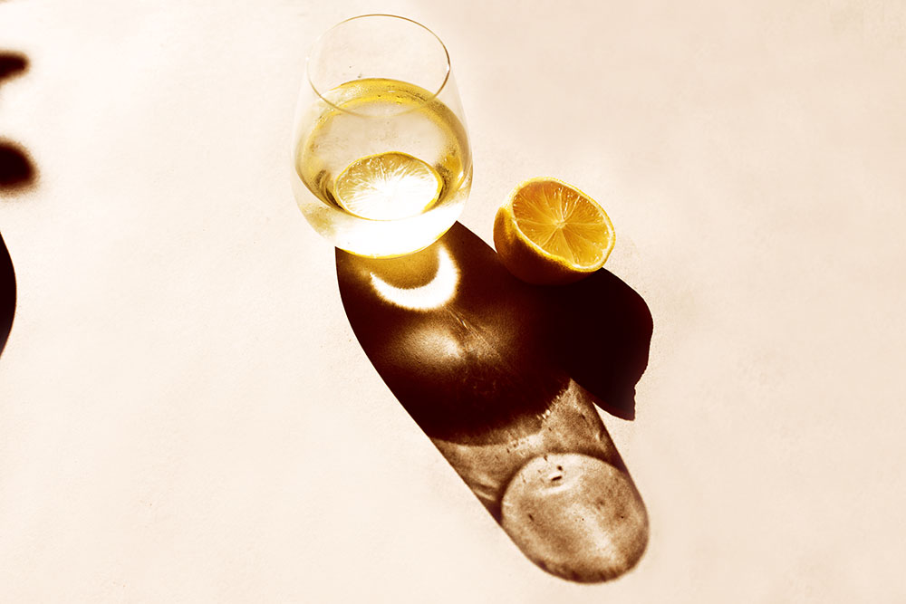 Lemon drink with a shadow