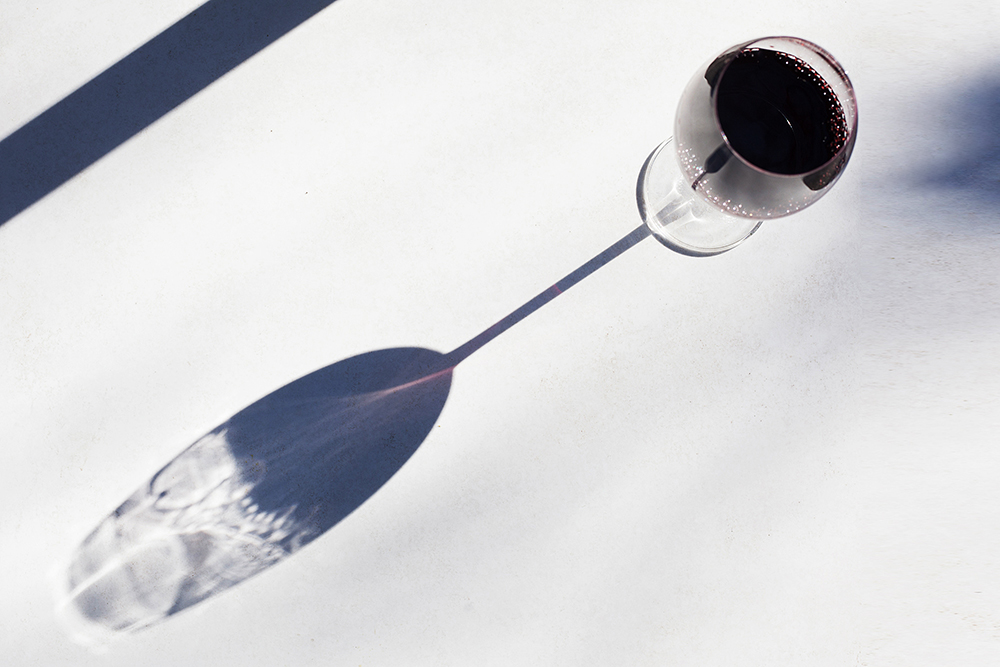 A glass of red wine in the winter sun